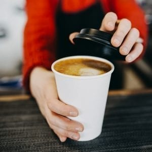 Barista serving coffee
